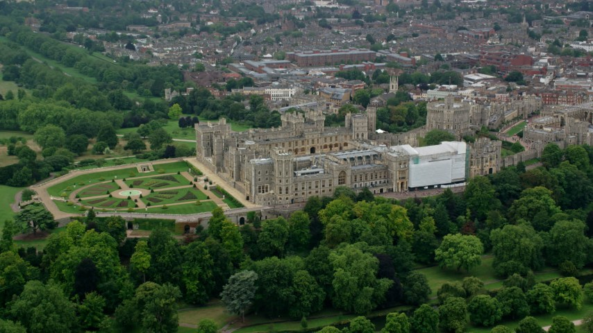 6K stock footage aerial video of flying by historic Windsor Castle and East Terrace Lawn, England Aerial Stock Footage | AX114_307