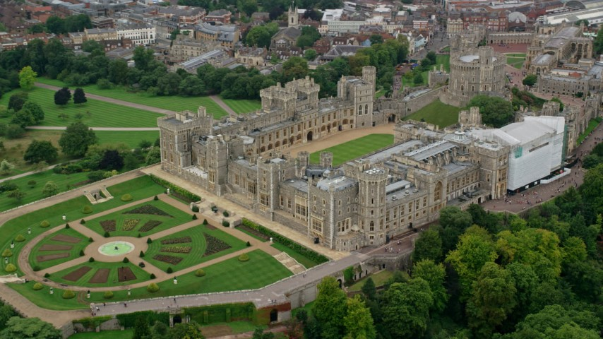 6K stock footage aerial video of orbiting Windsor Castle and East Terrace Lawn, England Aerial Stock Footage | AX114_308