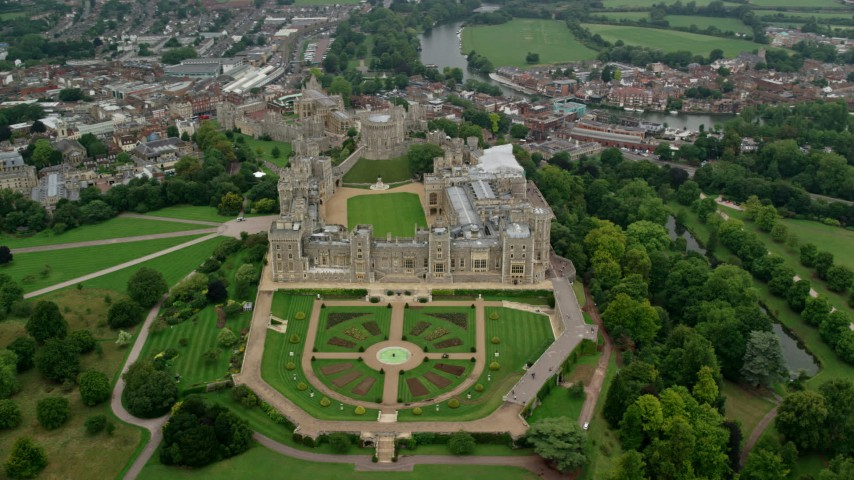 6K stock footage aerial video of an orbit of Windsor Castle and East Terrace Lawn, England Aerial Stock Footage | AX114_309
