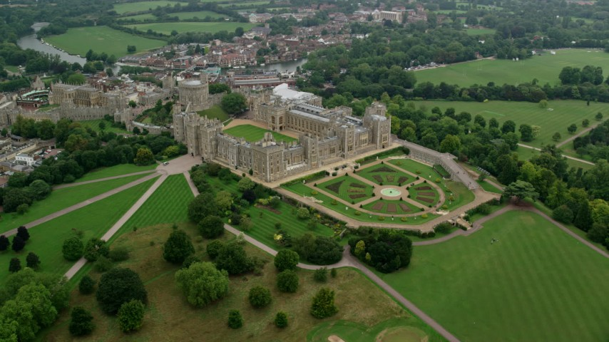 6K stock footage aerial video of orbiting historic Windsor Castle and the East Terrace Lawn, England Aerial Stock Footage | AX114_310