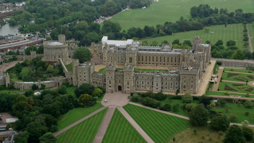 6K stock footage aerial video of orbiting the side of iconic Windsor Castle, England Aerial Stock Footage | AX114_311