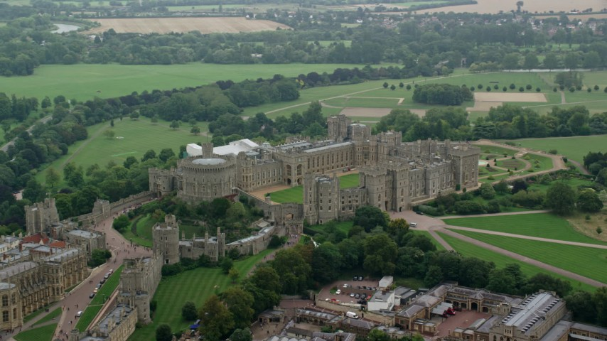 6K stock footage aerial video orbit historic Windsor Castle revealing St George's Chapel, England Aerial Stock Footage | AX114_313