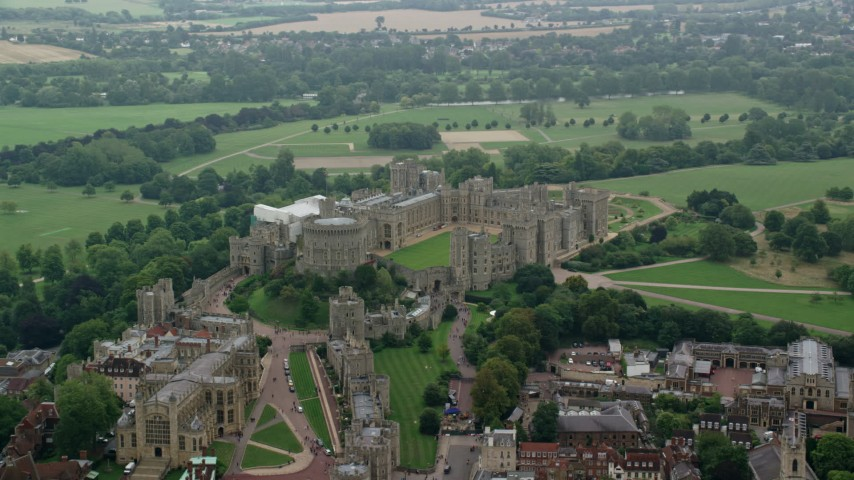 6K stock footage aerial video of passing by Windsor Castle and St George's Chapel, England Aerial Stock Footage | AX114_314