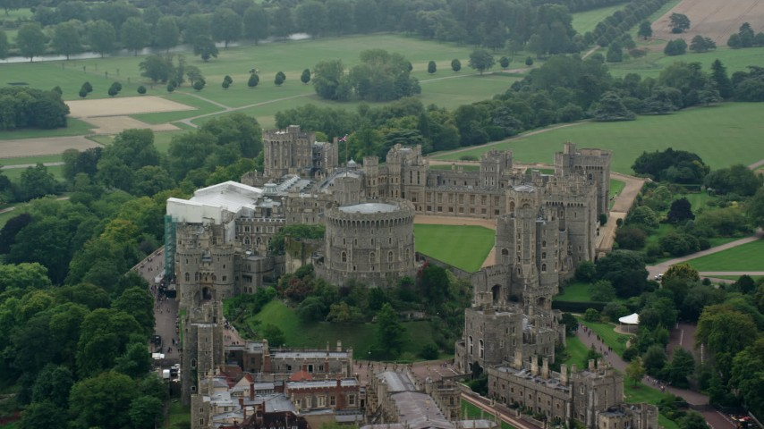 6K stock footage aerial video of an orbit around Windsor Castle, England Aerial Stock Footage | AX114_315