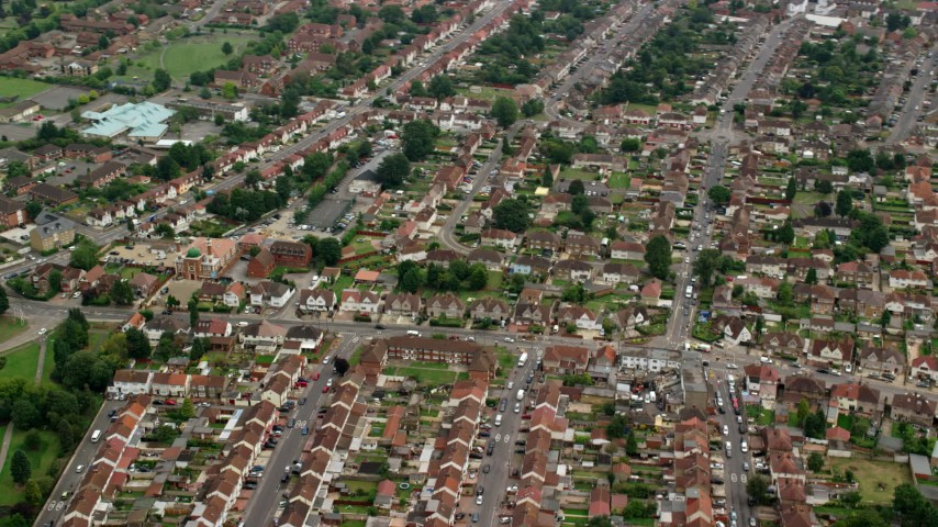 6K stock footage aerial video of orbiting a residential neighborhood and fly away, Slough, England Aerial Stock Footage | AX114_321