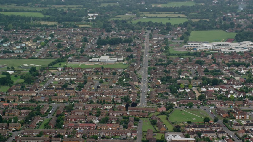 6K stock footage aerial video of residential neighborhood with row houses, Slough, England Aerial Stock Footage   AX114_322