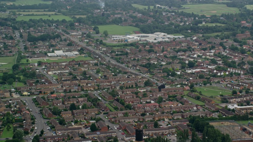 6K stock footage aerial video of orbiting row houses in a residential neighborhood, Slough, England Aerial Stock Footage | AX114_323