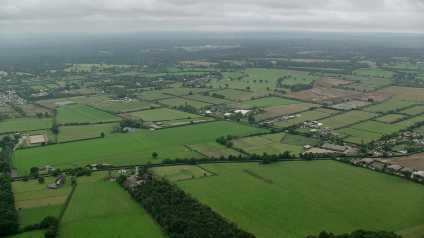 6K stock footage aerial video of flying over farms and farm fields, Windsor, England Aerial Stock Footage | AX114_334