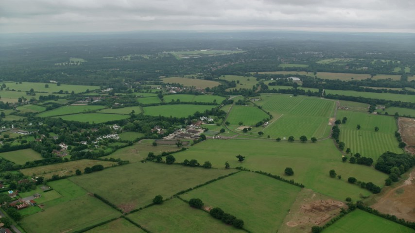 6K stock footage aerial video of flying over farms and fields in Windsor, England Aerial Stock Footage | AX114_336