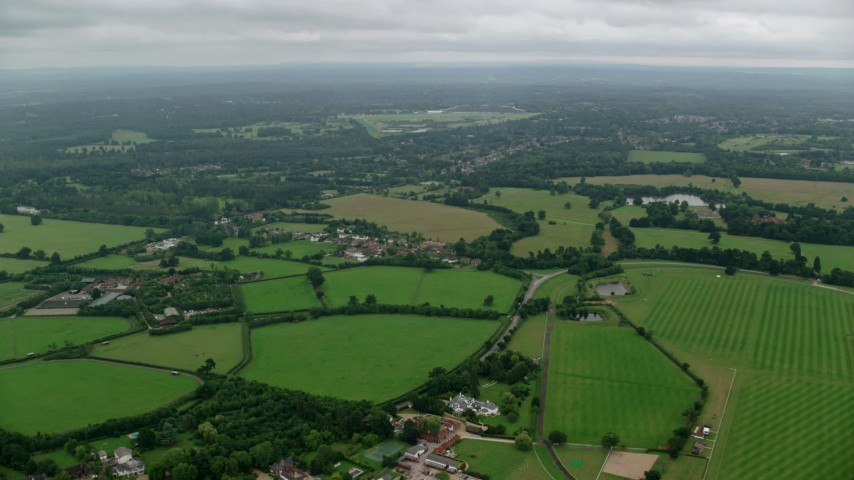 6K stock footage aerial video of farm fields and rural homes, Windsor, England Aerial Stock Footage | AX114_337