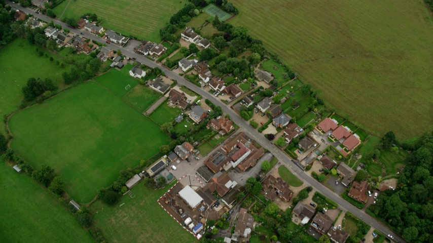 6K stock footage aerial video of tilting to a bird's eye view of rural homes and farm fields, Windsor, England Aerial Stock Footage | AX114_338