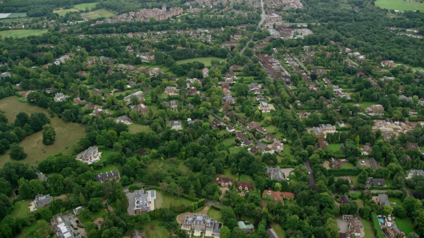 6K stock footage aerial video fly over upscale homes and trees, Virginia Water, England Aerial Stock Footage | AX114_348