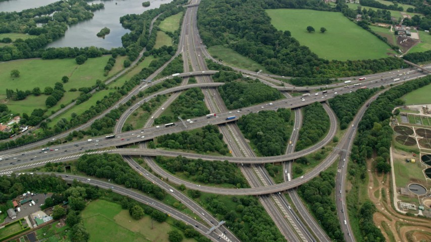 6K aerial video of the M3 and M25 Interchange, Egham, England Aerial Stock Footage AX114_350