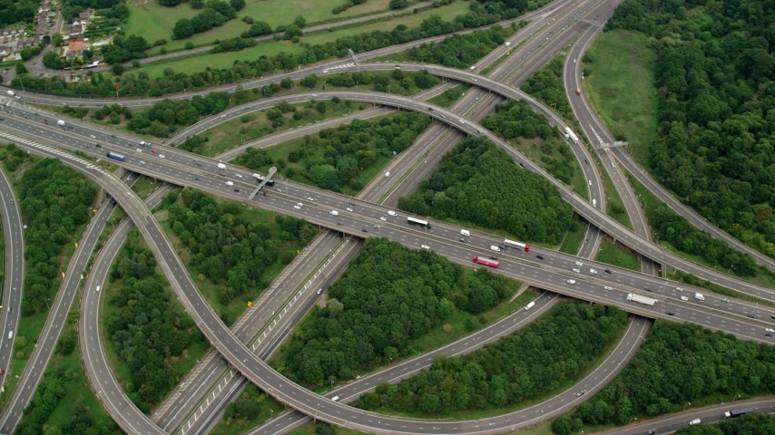 6K aerial video of orbiting M3 and M25 Interchange, Egham, England Aerial Stock Footage | AX114_351