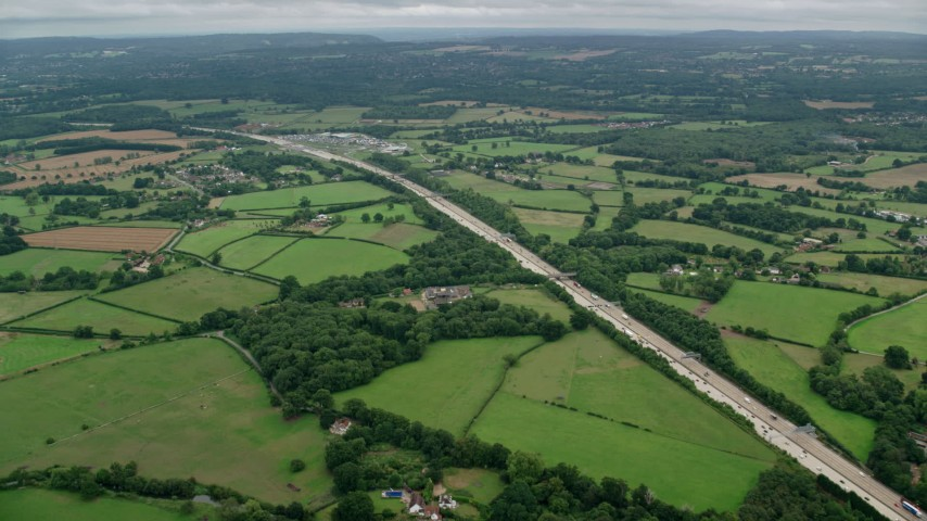 6K stock footage aerial video of the M25 and farm fields, Cobham, England Aerial Stock Footage | AX114_362