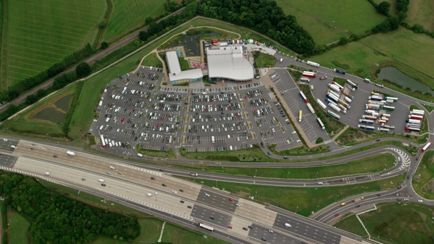 6K stock footage aerial video of a bird's eye view of shopping center by the freeway, Cobham, England Aerial Stock Footage | AX114_366