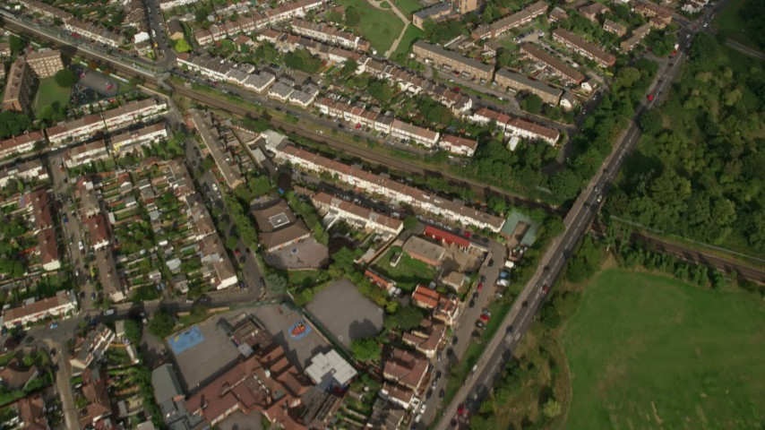 6K stock footage aerial video of a bird's eye view of suburban neighborhoods in London, England Aerial Stock Footage | AX115_046