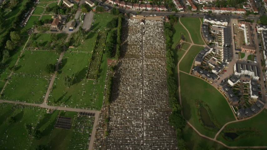 6K stock footage aerial video tilt to bird's eye view of a cemetery in London, England Aerial Stock Footage | AX115_048