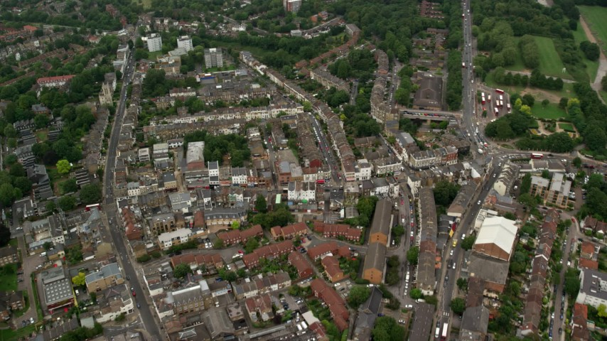 6K stock footage aerial video of flying over homes in a residential neighborhood, London, England Aerial Stock Footage | AX115_052