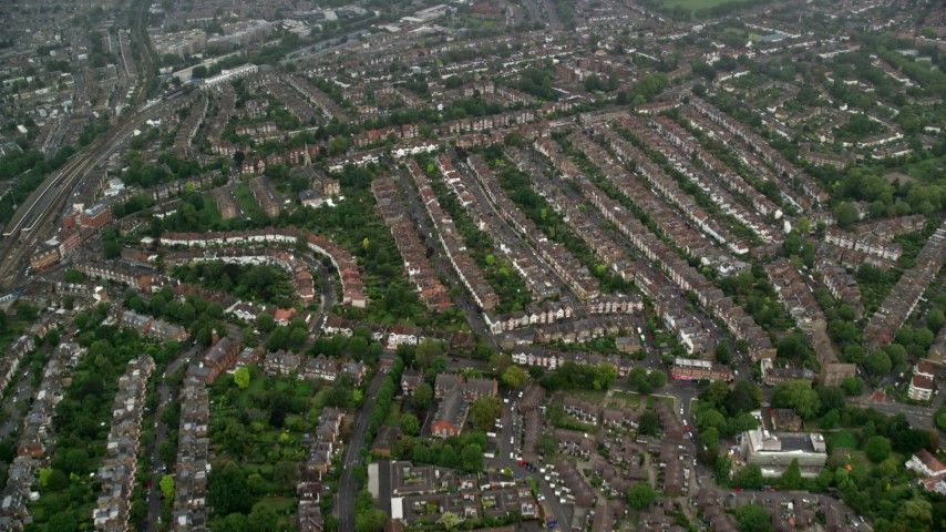 6K stock footage aerial video of flying over residential neighborhoods in the rain, London, England Aerial Stock Footage | AX115_054
