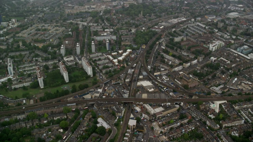 6K stock footage aerial video fly over residential area with train tracks in the rain, London, England Aerial Stock Footage | AX115_056