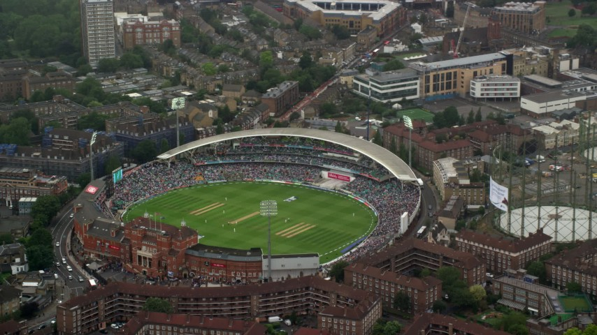 6K stock footage aerial video of orbiting The Oval cricket stadium in the rain, London, England Aerial Stock Footage   AX115_058