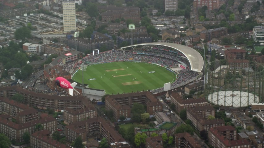 6K stock footage aerial video of orbiting The Oval cricket stadium in the rain, London, England Aerial Stock Footage   AX115_059