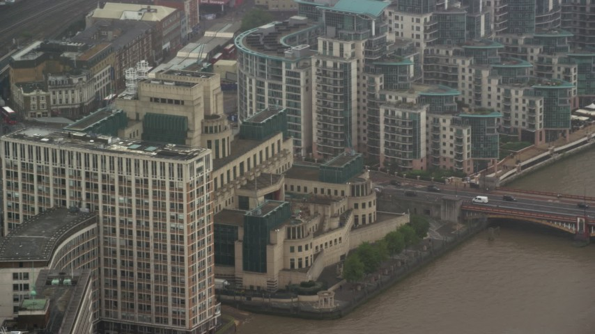 6K stock footage aerial video of orbiting MI6 Building in the rain, London, England Aerial Stock Footage | AX115_063