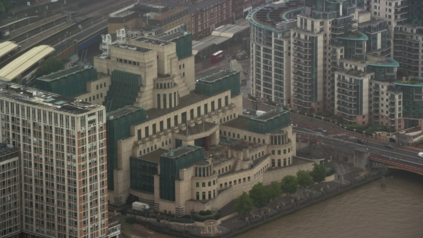 6K stock footage aerial video of orbiting MI6 Building in the rain, London, England Aerial Stock Footage | AX115_064