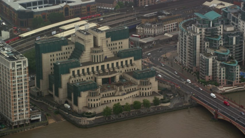 6K stock footage aerial video of orbiting the MI6 Building in the rain, London, England Aerial Stock Footage | AX115_065