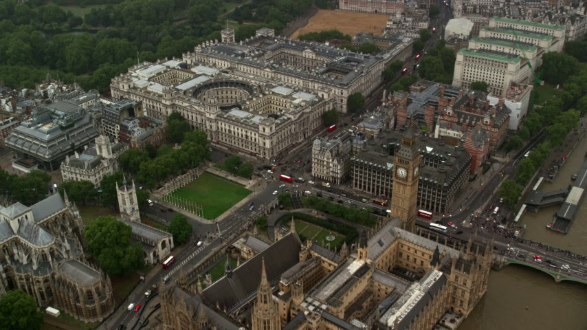 6K stock footage aerial video fly over Big Ben and Parliament toward Treasury and Foreign Office in the rain, London, England Aerial Stock Footage | AX115_074