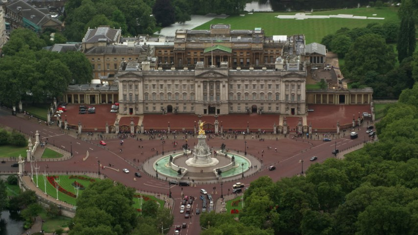 6K stock footage aerial video of Buckingham Palace and Victoria Memorial in the rain, London, England Aerial Stock Footage | AX115_075