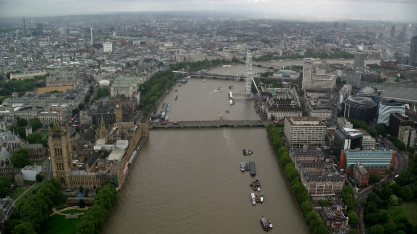 6K stock footage aerial video of Westminster Bridge while following River Thames past Parliament, London, England Aerial Stock Footage | AX115_087