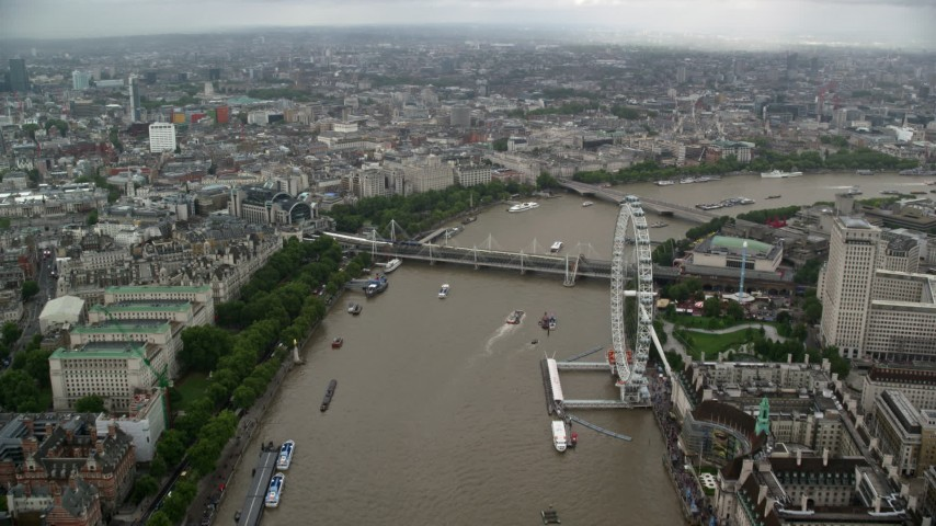 6K stock footage aerial video of Hungerford Bridge while flying over River Thames near London Eye, England Aerial Stock Footage | AX115_088