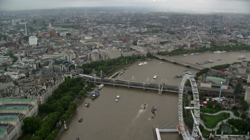Hungerford Bridge over the River Thames towards Somerset House, England Aerial Stock Footage | AX115_089