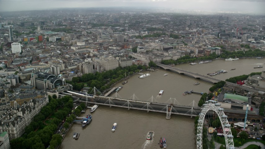 6K stock footage aerial video of Hungerford Bridge over the River Thames, fly towards Somerset House, England Aerial Stock Footage | AX115_089