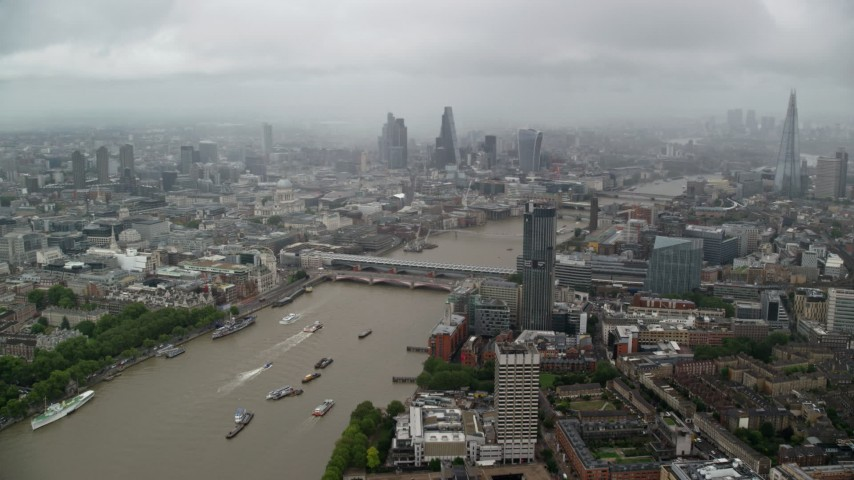 6K stock footage aerial video of Blackfriars Bridge over River Thames, Central London England Aerial Stock Footage   AX115_090