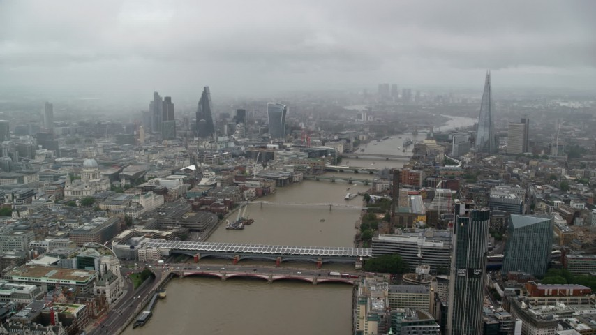 6K stock footage aerial video of flying over Blackfriars Bridge and River Thames, Central London England Aerial Stock Footage | AX115_091