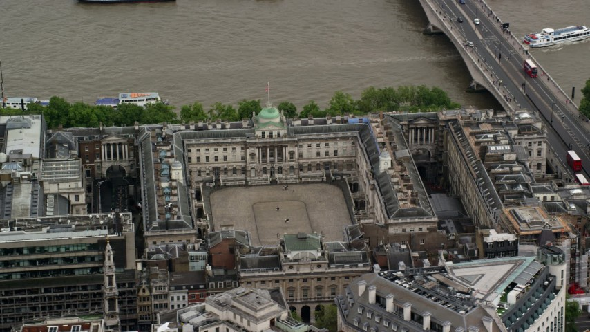 6K stock footage aerial video of an orbit of Somerset House along River Thames, London England Aerial Stock Footage | AX115_097