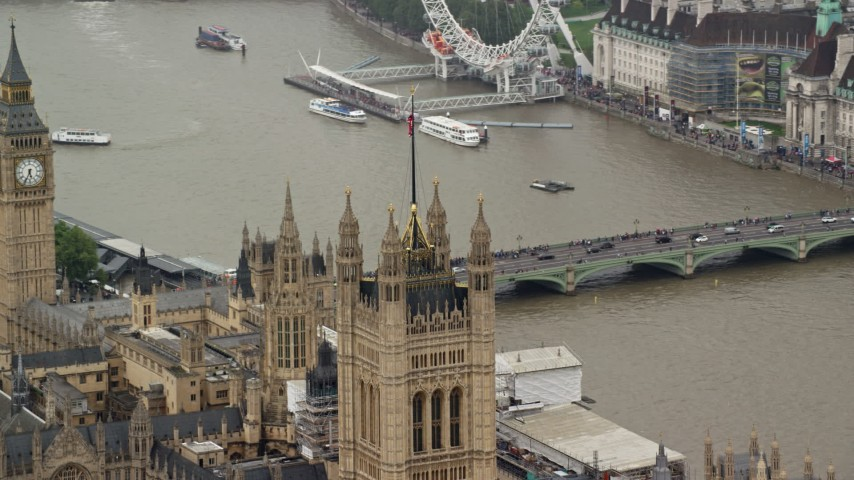 6K stock footage aerial video of British Flag atop Parliament reveal Big Ben, London England Aerial Stock Footage | AX115_103