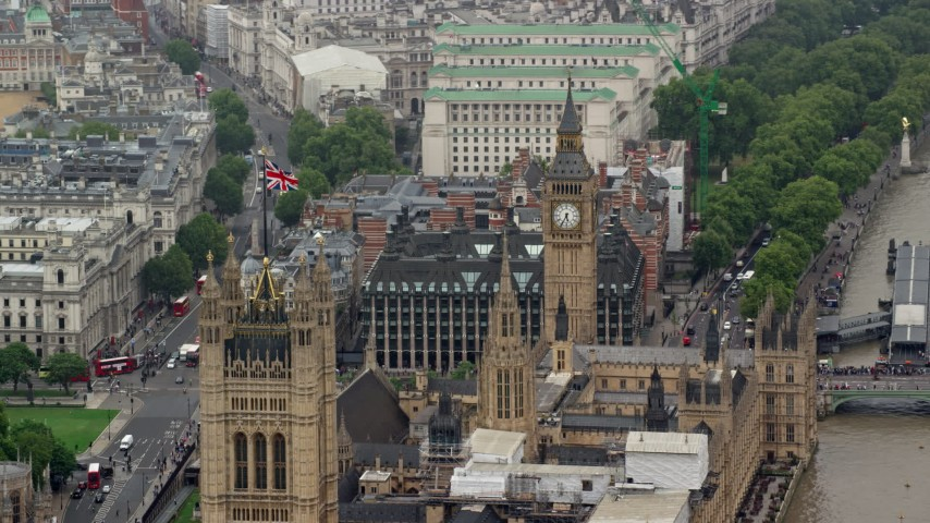 6K stock footage aerial video of British flag on Parliament near Big Ben, London, England Aerial Stock Footage | AX115_105