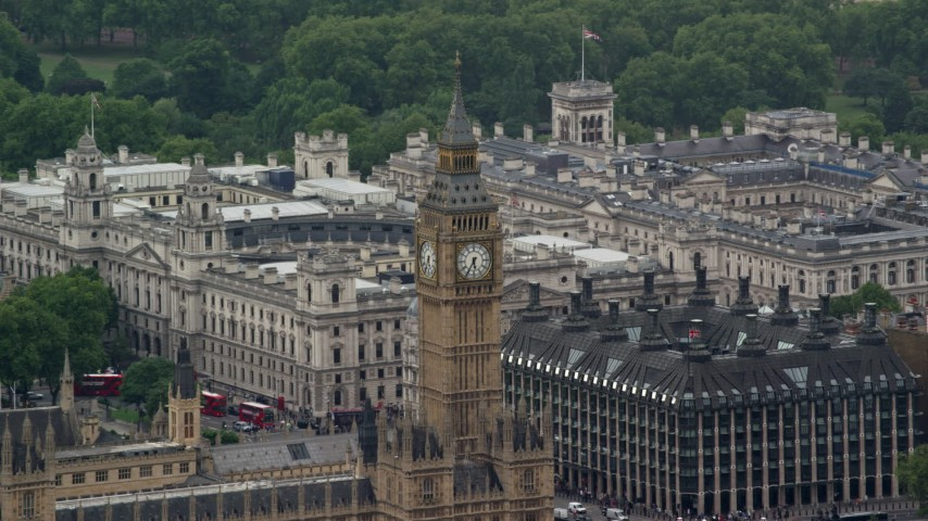 6K stock footage aerial video of orbiting Big Ben and Portcullis House, London England Aerial Stock Footage | AX115_107
