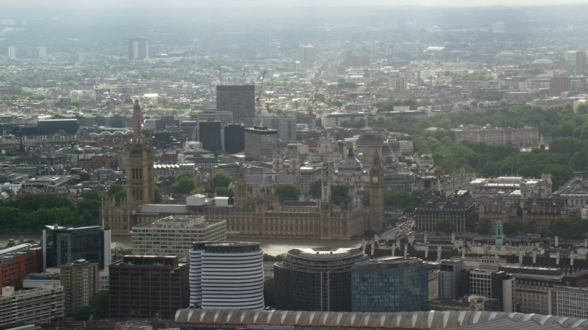 6K stock footage aerial video of Big Ben and Parliament against cityscape, London, England Aerial Stock Footage | AX115_110