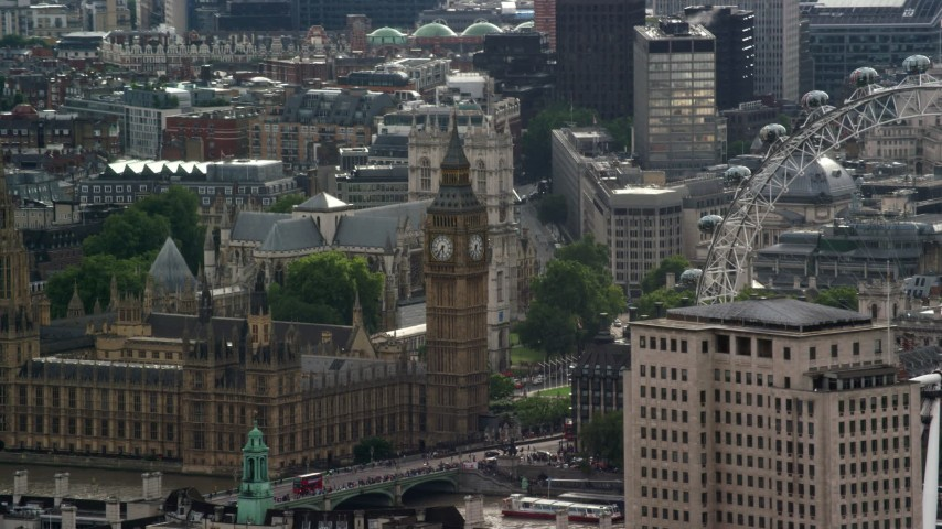 6K stock footage aerial video of Big Ben and London Eye among city buildings, England Aerial Stock Footage | AX115_112