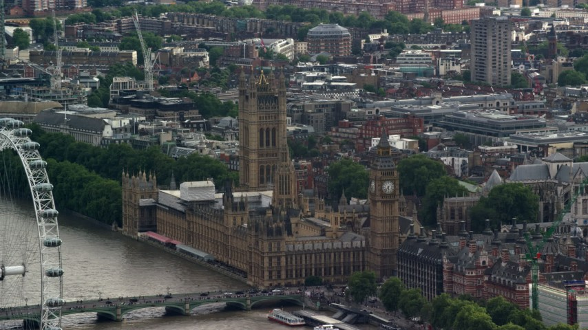 6K stock footage aerial video of Big Ben and Parliament beside the river, London, England Aerial Stock Footage | AX115_115