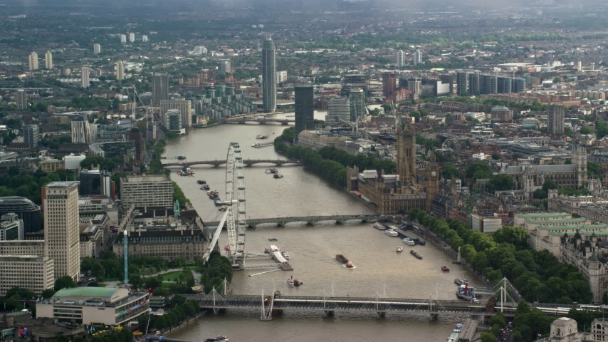 6K stock footage aerial video of Big Ben and London Eye, and bridges spanning River Thames, England Aerial Stock Footage | AX115_116