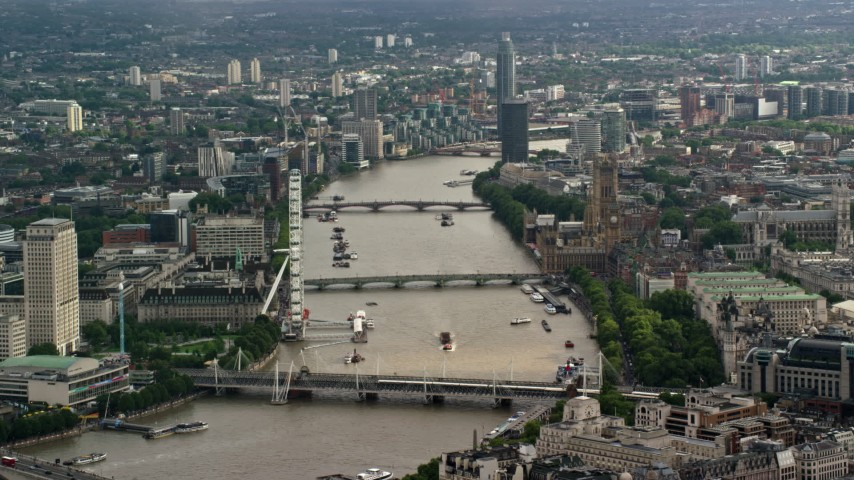 6K stock footage aerial video of Parliament and London Eye, and Bridges over the River Thames, England Aerial Stock Footage | AX115_117