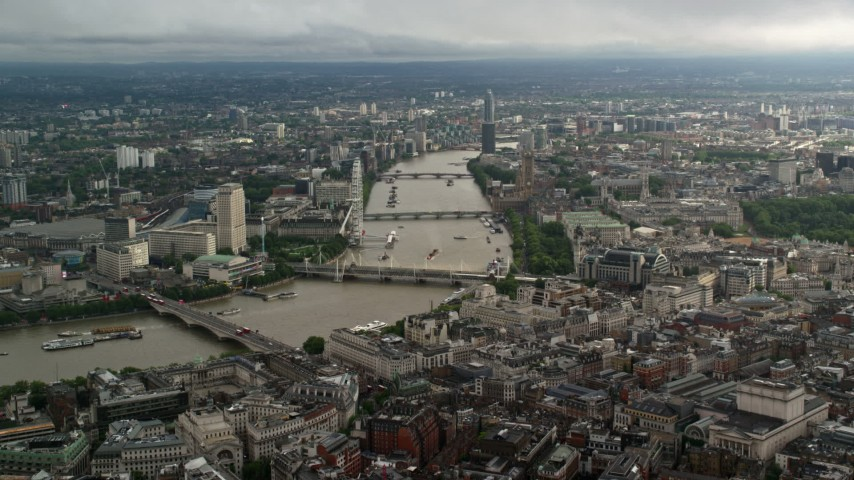 6K stock footage aerial video approach bridges over the River Thames and London Eye, England Aerial Stock Footage | AX115_118
