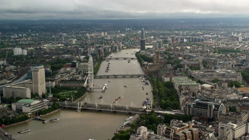 Bridges spanning the River Thames through the city, London England Aerial Stock Footage | AX115_120