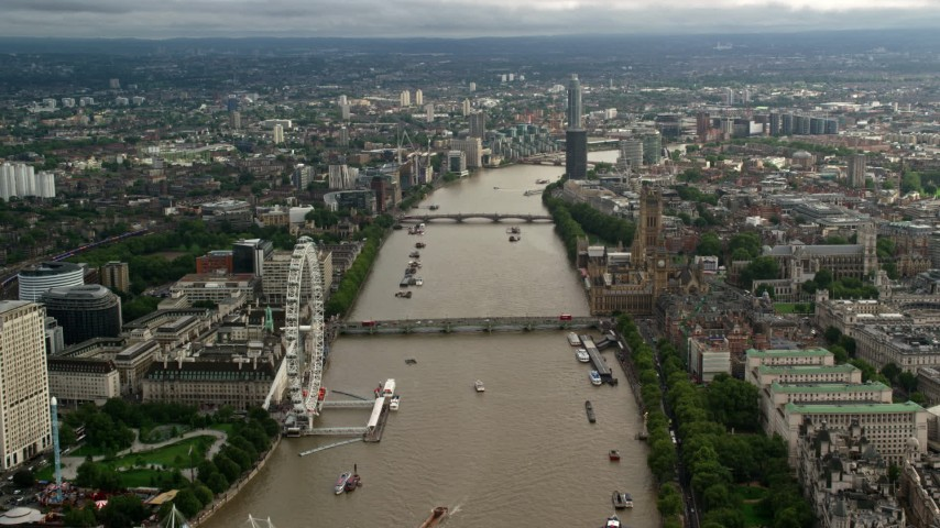 6K stock footage aerial video of bridges spanning the River Thames between London Eye and Parliament, England Aerial Stock Footage   AX115_121